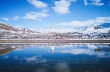 雪后稻城。看白色的雪山。