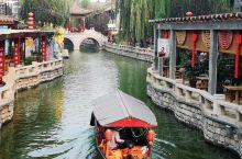 滦县古城游玩,古城有漂亮的仿古建筑。古城按照北方的古民居形式,有水路相通,风光雅致,在古城内漫步拍照