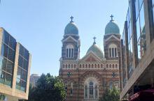 天津西开教堂1925年法国设计建造,劝业场老百货大楼都是那个年代的建筑